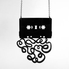 Mix tape necklace. I have one and love it http://www.etsy.com/listing/62390184/the-mixtape-breakup-necklace-black