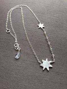 """Starry Night Necklace; this beauty has handcrafted fine silver (.999%) stars wire wrapped onto a delicate sterling silver chain.Dainty crystal quartz is added with extendable links for self adjusting from 16""""-17."""" The chain is finished with an icy pale blue aquamarine gemstone at one end.($50) Only one available. #silverjewelry #modernjewelry #starnecklace"""