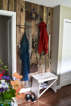 Pallet wood feature closet wall in bedroom for hanging clothes, via Funky Junk Interiors