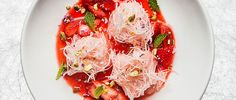 Use the season's fresh strawberries to make faloodeh, an Iranian dessert of rose granita with frozen rice noodles.