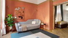 Bands of terracotta and sand-coloured paint wrap around the walls of Trevi House, a one-bed apartment in Rome that's been overhauled by Studio Venturoni. Rome Apartment, Apartment Interior, Blue Headboard, Prefabricated Houses, Wooden Ceilings, One Bed, Living Room Sofa, Living Rooms, Small Rooms