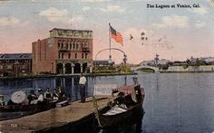 The bridge in the background is not the Coral Canal bridge, although it is similar - the canal directly behind the gondola is Lion Canal. If we could look further to the right, we would see Grand Canal, and over to the left, just outside of the shot is Coral Canal. The large building behind the man on the dock is the Antler Hotel, which is said to have housed a speakeasy in it's basement during prohibition.