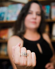 Bookshelf ring!  Kelly Justice had this ring custom-made to celebrate her 20th year as a bookseller  and her first year as the owner of Fountain Books. Photo by Ash Daniel - Shelf Life, Richmond Magazine