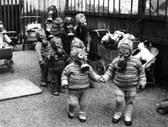 Teach Rock - Liverpool school children wearing gas masks during the war - In the bombings of London created a scary environment for families with regards to their children. Gas masks were commonplace throughout the UK, just to be safe.