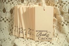 Set of 50 Wedding Best Wishes to the Bride and Groom Stamped Hang tags. $26.50, via Etsy.