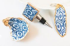 These blue and white ikat design gifts are perfect for hostess gifts.   These are handmade in the USA. Shell Jewelry, Jewelry Dish, Custom Wine Bottles, Oyster Shells, Wine Bottle Stoppers, White Home Decor, Hostess Gifts, Ikat, Oysters