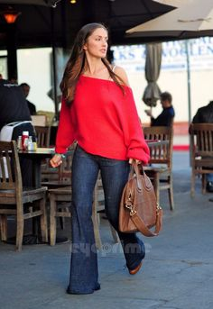 love the sweater...and the bag.I am not one for bell bottom jeans.
