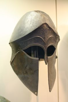 bronze 'Corinthian' helmet in the Olympia Archaeological Museum. Greek Helmet, Corinthian Helmet, Helmet Armor, Ancient Armor, Classical Greece, History Encyclopedia, Greek Warrior, Renaissance, Archaeological Finds
