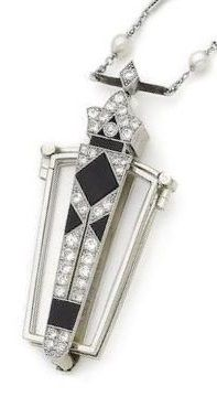 A pair of art deco, onyx and diamond lorgnettes, circa 1930. The tapering rectangular handle with stylized trefoil finial, set with polished onyx and brilliant-cut diamonds, opening to reveal a pair of rectangular spectacles with polished frames