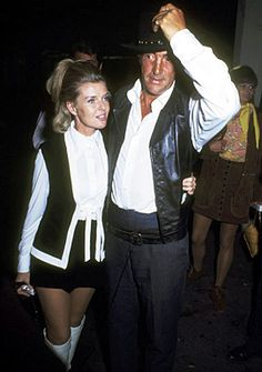May 25th, 1968; Dean Martin and wife Jeannie Martin attends the 15th Annual SHARE Boomtown Party at the Santa Monica Civic Auditorium. (Looks like Dean is wearing his 'Five Card Stud' hat)