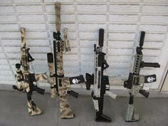 Excellent Collection of Modified Rifles. Whoever painted these have skill