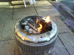 Hacked firepit made from washing machine tub and barbecue grill bowl.