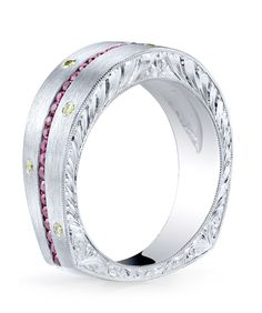 Engraved platinum gents ring with a sandblast finish, featuring channel set ruby melee 0.59ctw, accented with 0.115ctw of yellow diamonds.