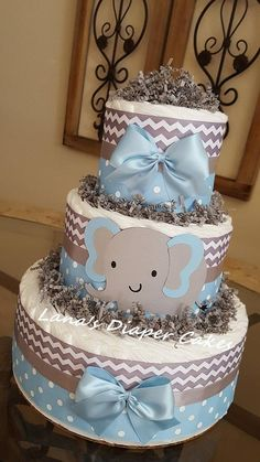 3 Tier Blue And Gray Elephant Diaper Cake Ingredients: * 50 - Premium Diapers (size * * usable diapers * Cute Elephant embellishments * The cake Measurements approximately: X * High Quality Ribbons * This adorable cake will arrive fully as Baby Shower Cakes For Boys, Baby Boy Cakes, Baby Shower Diapers, Baby Shower Cookies, Baby Shower Fun, Baby Shower Gifts, Elephant Diaper Cakes, Diaper Cake Boy, Mini Diaper Cakes
