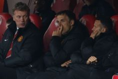 Moyes watches on with coaches Phil Neville and Ryan Giggs