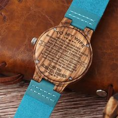 Get your wife something special! This is a beautiful watch made from real wood. The watch case is made from wood and the strap made from genuine leather. Also make a Great Birthday, Anniversery Gift. The message is laser engraved on the back of the watch so it will last forever. This watch will make the perfect gift for your wife and she will love it! FEATURES Clasp Type: Buckle Case Material: Wooden Band Material Type: Leather Movement: Quartz Dial Window Material Type: Hardlex Band Lengt