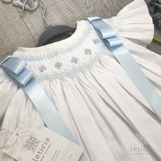 Beautiful Handsmocked Bishop dress with angel sleeves and baby blue satin ribbons. Hand embroidered details with pearls. Girls Baptism Dress, Baby Girl Baptism, Baptism Gown, Baby Girls, Smocked Baby Dresses, Baby Dress Design, Angel Gowns, Heirloom Sewing, Smocking