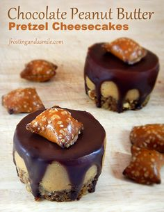 Creamy peanut butter cheesecakes with crunchy pretzel crusts and chocolate glaze.  The perfect sweet, salty, creamy, crunchy dessert!