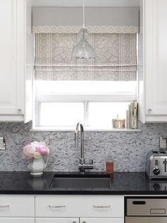 window treatment. Pattern on shade, solid on valance