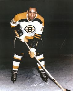 Willie O'Ree, first player of NHL of African descent, with the Boston Bruins in 1960