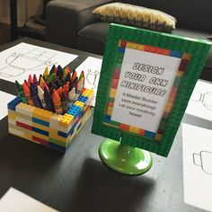 DIY Lego brick crayon holder and activity sign for our Lego Movie themed birthday party.  Décor and function!  Click or visit FabEveryday.com for more photos and instructions for many Lego-themed party DIY projects
