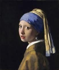 Vermeer - Girl with pearl earring.  Her gaze is forever timeless.