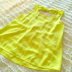 Neon Yellow Tank Neon yellow tank with bow on back. Tops Tank Tops