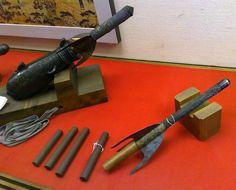 Antique samurai bo-hiya (fire arrows), the bo-hiya on the left is loaded into a hiya taihou (fire arrow cannon).