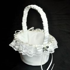 White butterfly and ribbons decorated flower girl basket