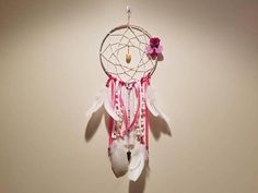 Check out this item in my Etsy shop https://www.etsy.com/listing/550032321/handcrafted-floral-dream-catcher-with