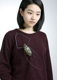 Yojae Lee born in Republic of Korea, now living and working in Seoul. She received M.F.A from Kookmin University.Awarded in 2015 with Silver Prize Taiwan International Metal Craft Competition, Prize Marzee Graduate Prize 2015. - Yojae Lee Brooch: Insects_ long - horned beetle, 2014 Frog's skin, shell, sterling silver, brass, polymer clay 13.2 x 27 x 3.2