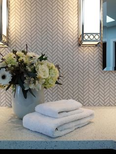I have this counter top in my kitchen, and LOVE it.   But, now I am loving it with this herringbone backsplash!