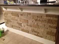 Kitchen to coodinate with feature stone wall  Stacked stone bar