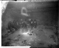 Antelope priests in a kiva preparing for the snake dance in an Indian religious ritual, Oraibi, ca.1900