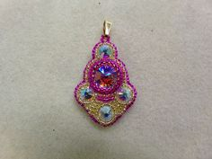 Kelly from Off the Beaded Path, in Forest City, North Carolina shows you how to make a bead embroidered pendant. Kelly also has written patterns and kits ava...