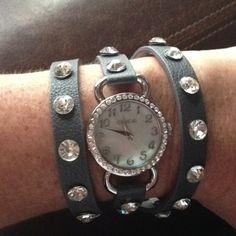 Dark grey wrap watch.