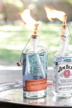 DIY Tiki Torch Bottles - now I know what to do with all my saved bottles. Such a cute idea and much simpler than candles! Liquor Bottle Lights, Empty Liquor Bottles, Whiskey Bottle Crafts, Bottle Top Crafts, Diy Bottle, Alcohol Bottle Crafts, Alcohol Bottles, Bottle Art, Vodka Bottle