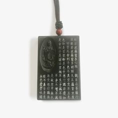 The Heart Sutra which is recited in Zen Temples every day is painstakingly handwritten in Chinese characters on the front and back of this strikingly beautiful amulet. The Buddha of Compassion – Guan Yin – stands on a lotus on the left-hand side. This Jade can be used as an amulet or a hanging.Amulet (also called tali Heart Sutra, Chinese Characters, Guanyin, Amulets, Jade Green, Inner Peace, Temples, Compassion, Lotus