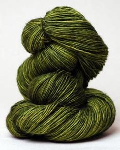 100% superwash merino wool, single-ply fingering to sport weight yarn. Color: Jade. Each incredibly soft skein is hand-dyed in small dye lots. US$22.00/420yds what a gorgeous blend of greens