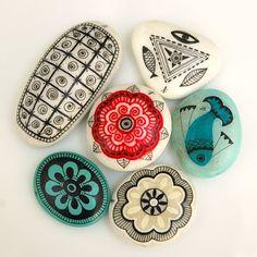 handpainted stones - sun mandalas and ancient symbols