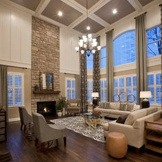 Find Traditional Home Ideas and Traditional Home Decor Online- I like the ceiling colors for updating older homes, and treatment of brick to enhance an outdated fireplace. Suits the height of the room very well.