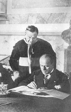 Mussolini signs the Lateran Pact of 1929, which brought into being the Vatican City State.