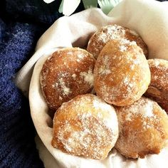 Bird-view shot of 6 beignets on a bowl cover with a white cloth