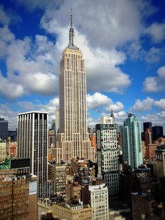 The Empire State Bulding uses 62,000 cubic yards of concrete. 1 cubic yard of concrete could weigh at about 3500 lbs, which means that it is 108,500 tons (or 217 million pounds)!