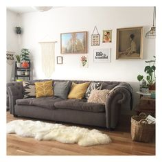 my front room styling... mid century, boho, macrame, botanical prints and vintage vibes... oh .. and lots of plants too