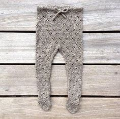 Knitting for Olive Baby tights with clover pattern.