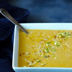 Keto curried squash soup in a square white bowl