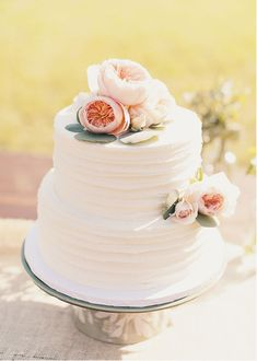 nice texture for buttercream cake - add asymmetrical floral embellishments from florist that match the rest of the design - privet berry, succulent & cream garden rose