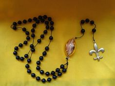 New Orleans Saints Football Catholic Rosary Beads, $17 on Etsy --- (Look: http://etsy.me/qlHLpV) This amuses me to no end, which I'm sure is just one more thing I'm going to Hell for. #NOLA #Aints #WhoDat