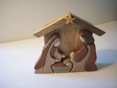A great addition to your holiday decor. This Wood Nativity scene was created using a variety of woods to enhance the scene, using the Intarsia method. It measures wide by tall and stands alone on any surface you desire. A beautiful scene from woodaplenty Christmas Nativity Scene, Christmas Wood, A Christmas Story, Christmas Crafts, Nativity Sets, Bois Intarsia, Wood Projects, Woodworking Projects, Intarsia Wood Patterns
